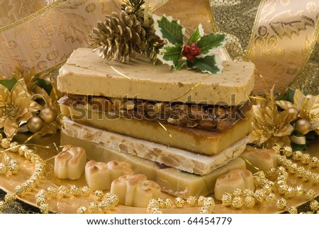 Typical Spanish Christmas nougat in a golden plate