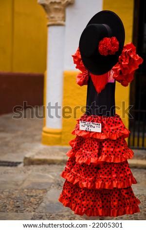 Typical spanish flamenco dress in a souvenir shop, Spain - stock photo