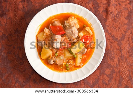 "Typical spanish food: tuna stew with potatoes and peppers. It's called ""Marmitako"" and is from the basque country."
