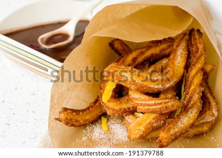Typical Spanish fried pastry for dessert - churros - stock photo