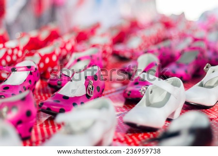 Typical spanish gipsy shoes on their boxes. Shallow depth of field. - stock photo