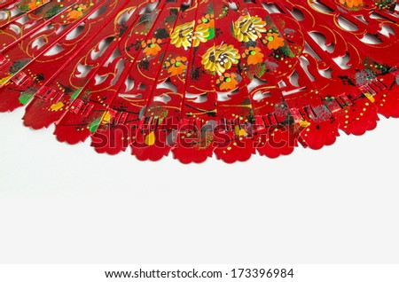 Typical spanish red fan over a white background. Detail of the decoration based in flowers - stock photo