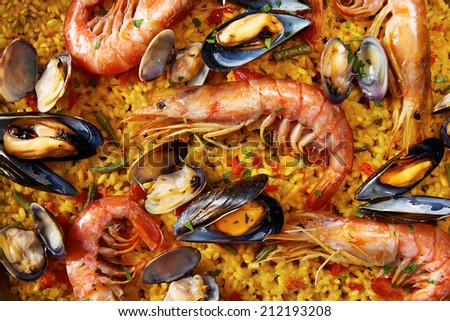 Typical spanish seafood paella close-up - stock photo
