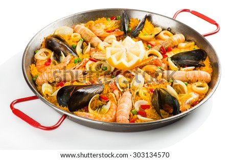 Typical spanish seafood paella in traditional pan isolated on white background - stock photo