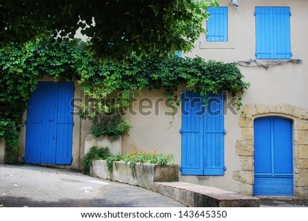 Typical stone house with blue doors and windows, Lourmarin village, Provence, France