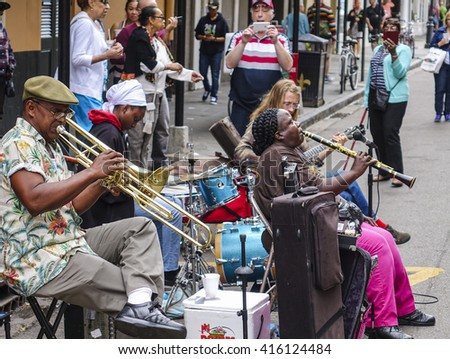 Typical street musicians for jazz music in New Orleans - NEW ORLEANS, LOUSIANA - APRIL 17, 2016