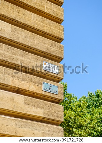 Typical street name plaquer on the streets of Aix-En-Provence - Rue des Cordeliers, or Anciano Carreiro Esquicho Musco - stock photo