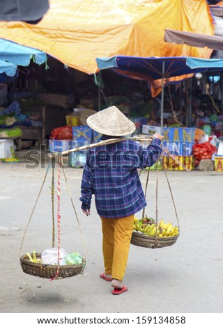 Typical street vendor in Hoi An, Vietnam - stock photo
