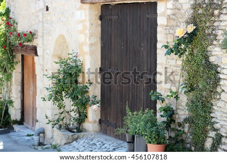 Typical street with old houses of a village in La Provence, wooden doors, beautiful view, outdoors - stock photo