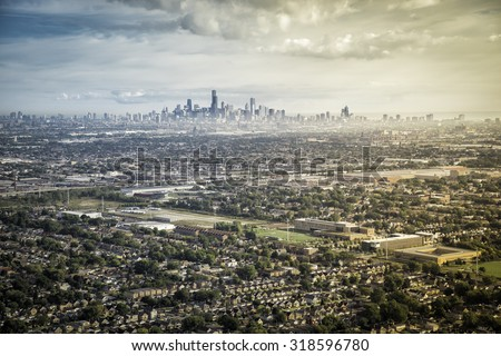 Typical Suburbs Buildings Against Chicago Downtown - wide angle - stock photo