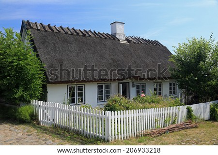 Typical summer cottage in North Zealand, Denmark with thatched roof - stock photo