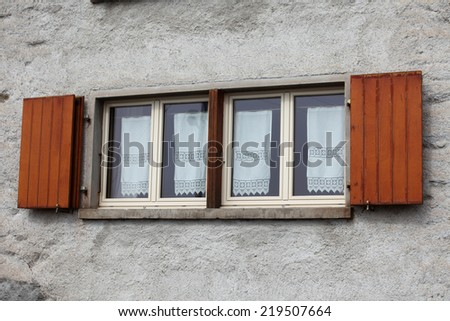 Typical  Swiss window with louvered shutters