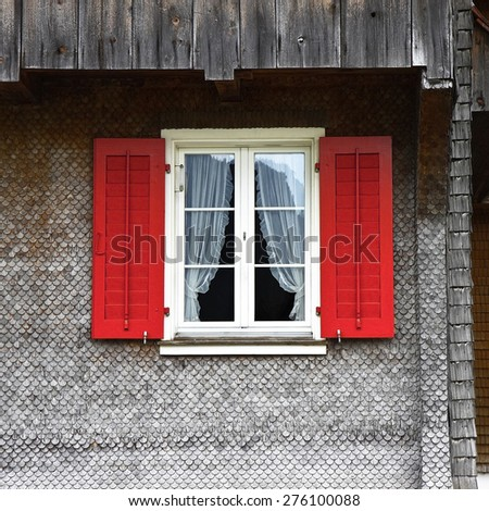 Typical swiss window with shutters in red - stock photo