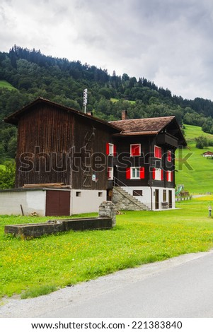 Typical swiss wood house with decorations and flowers, Switzerland. - stock photo