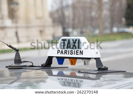Typical taxi in Paris France - stock photo