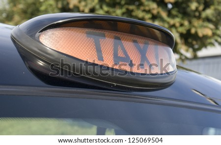 Typical Taxi sign of a London Cab. - stock photo