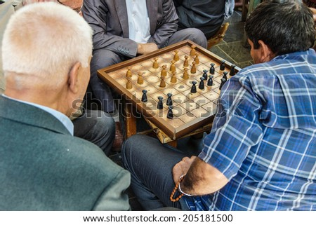 Typical tea house scene with men playing boardgames and talking  in Urfa bazaar,  Turkey - stock photo