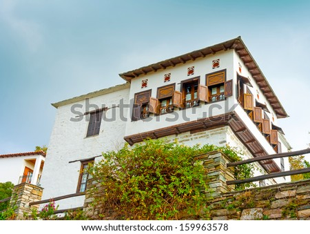 Typical traditional house at Portaria village on Pilion mountain in central Greece - stock photo