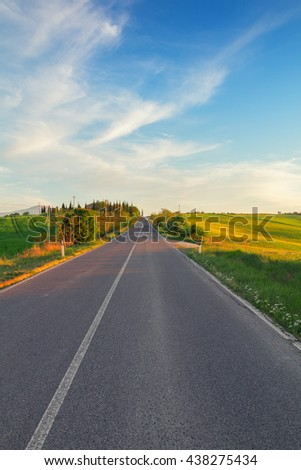 Typical Tuscany landscape and road springtime at sunset  in Italy,Europe