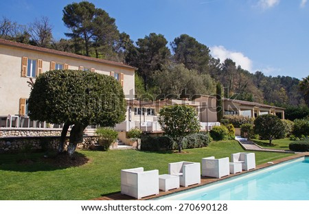Typical vacation house with a pool in the Southern part of France - stock photo
