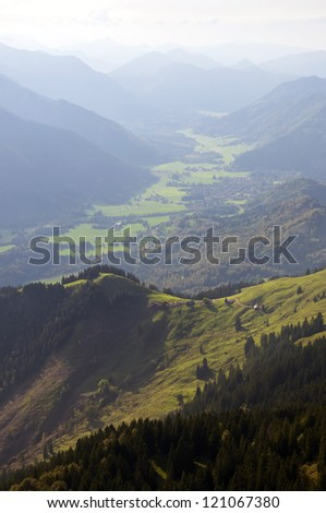 Typical Valley in the Bavarian Alps, seen from a mountain in early fall - stock photo