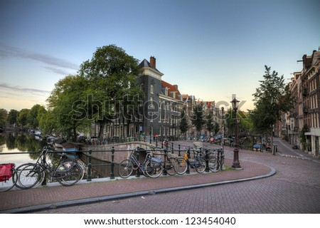 Typical view on the canal bridges in Amsterdam, the Netherlands, early in the morning. HDR - stock photo