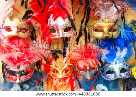 Typical vintage venetian colored masks, symbol Annual carnival, in souvenir shop on a street of Venice, Veneto, Italy. - stock photo