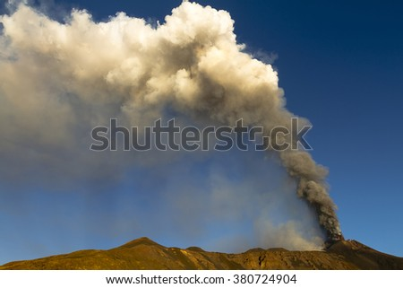Typical volcanic plume of Mount Etna erupting - stock photo