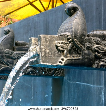 Typical water fountain, Dwarika's Hotel, Kathmandu, Nepal - stock photo