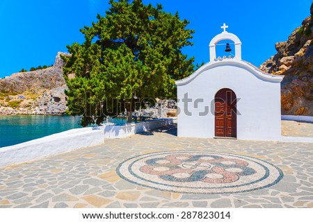 Typical white church in St. Paul's bay near Lindos town, Rhodes island, Greece - stock photo