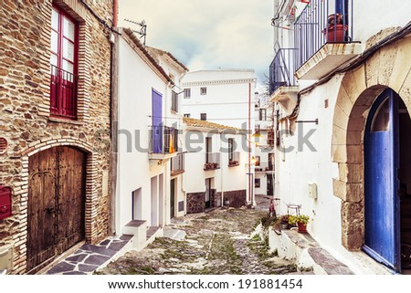 Typical white streets of Cadaques, Costa Brava. - stock photo