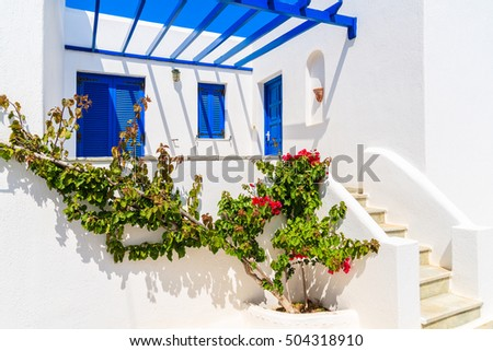 Typical whitewashed Greek house in Naoussa town on Paros island, Greece
