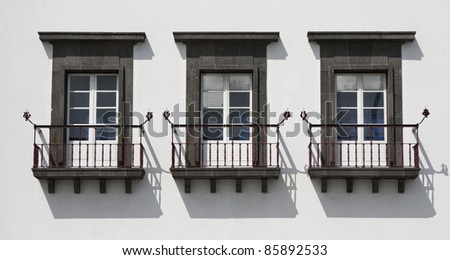 Typical windows with balcony of Azores, Portugal. - stock photo