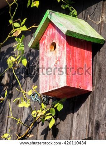 typical wooden birdhouse - closeup - photo - stock photo