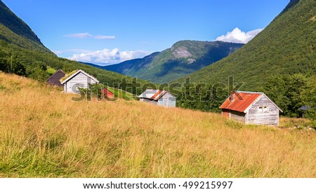 Typical wooden cabins in a valley in Norway