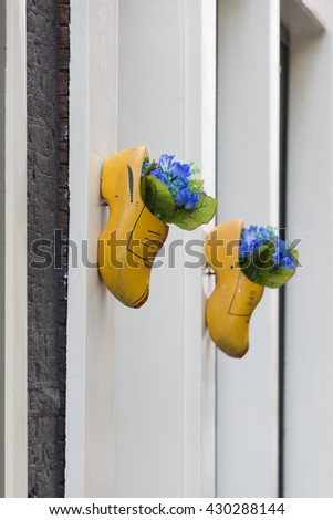 Typical wooden clog shoes used in a facade in Amsterdam as decoration (portrait format).