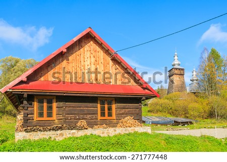 Typical wooden house in Beskid Niski Mountains in autumn season, Poland