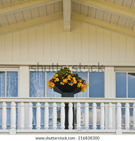 Typical Wooden Loft Decorated with Fresh Flowers in the Bavarian Alps, Germany - stock photo