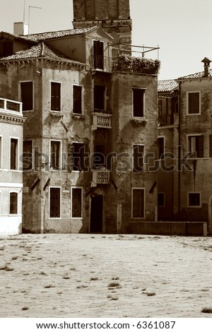 Typical, worn shabby building on an empty square in Venice Italy - stock photo