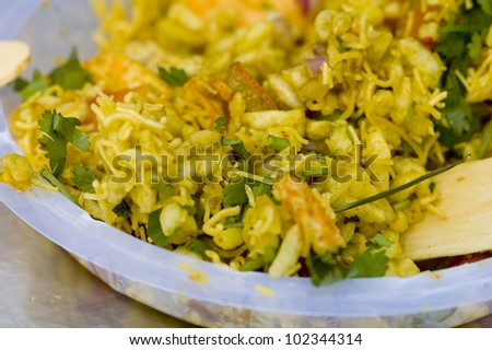 Typically Indian street food on a plastic plate - stock photo