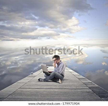 typing at the lake - stock photo