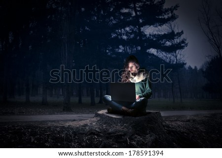 typing in the woods - stock photo