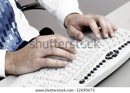Typing on computer keyboard - stock photo