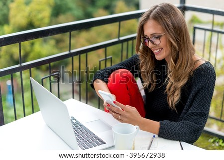 Typing on smart phone - stock photo