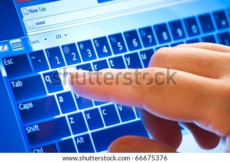 typing on touch screen virtual keyboard - stock photo