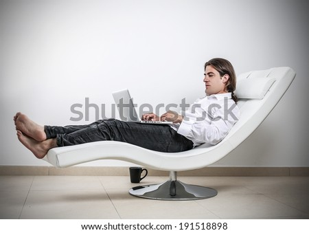typing relaxed man - stock photo