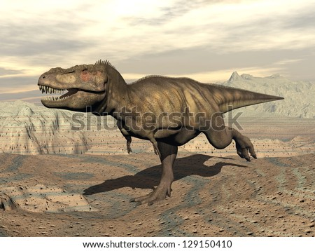Tyrannosaurus dinosaur running in the desert by cloudy day - stock photo