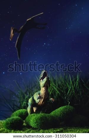 Tyrannosaurus fighting with a prehistoric flying bird - stock photo