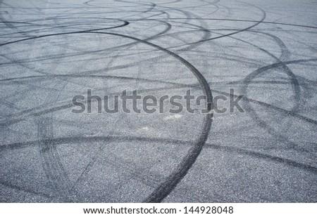 Tyre burnout marks on asphalt road - stock photo