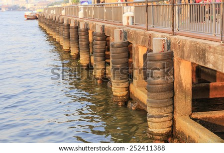 tyres pole bumping of port for the ship   - stock photo